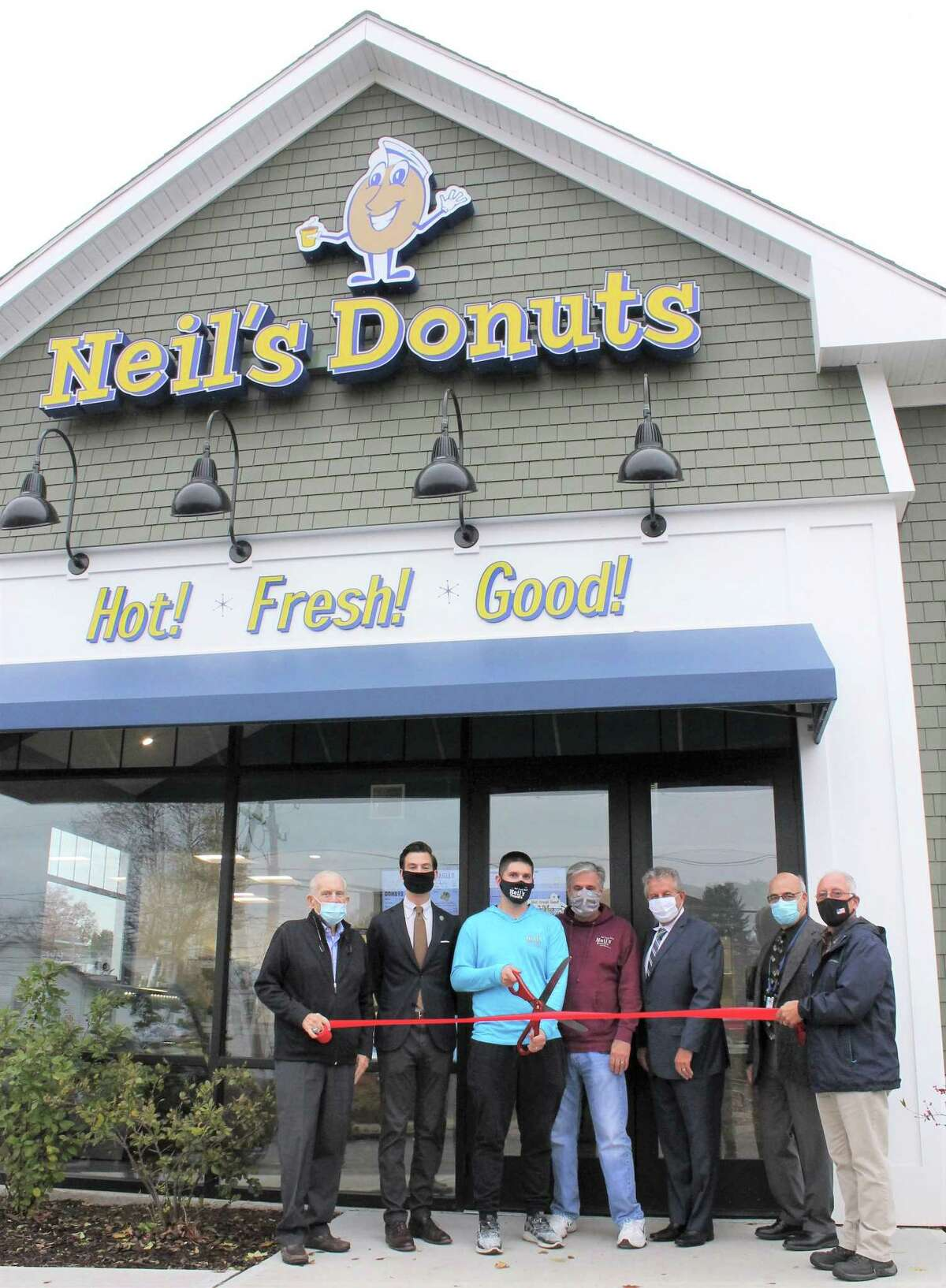 Neil's Donuts celebrated the official grand opening of its second location in Middletown Nov. 12. From left are Middlesex County Chamber of Commerce President Larry McHugh, Mayor Ben Florsheim, co-owner Rob Bukowski, Rob's father and co-owner Neil Bukowski, Kempenaar Real Estate President Robert Kempenaar, Economic Development Specialist for Middletown Planning, Conservation & Development, Thomas Marano; and Councilman Phil Pessina.