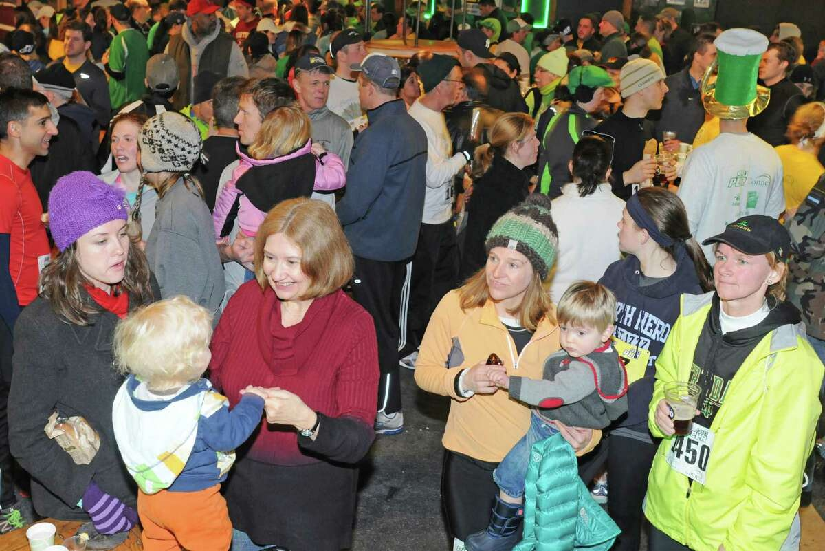 Onlookers watch the band on stage at The Diaper Bank 5K Road Race post race party in New Haven in 2013.