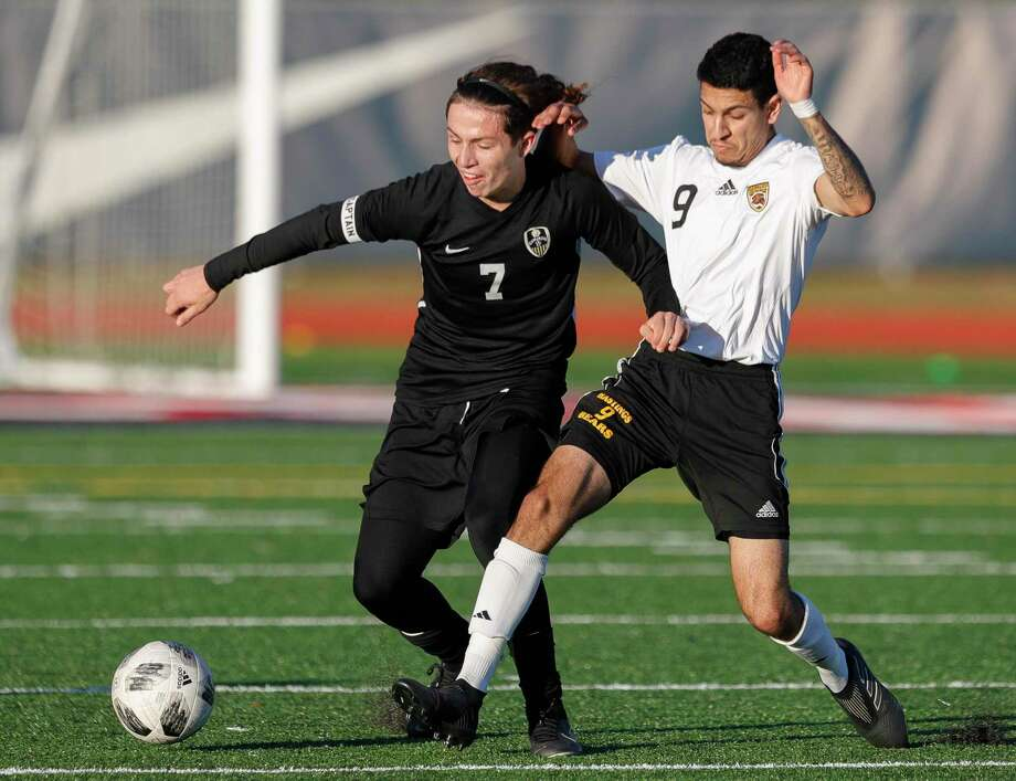 Conroe's Dayton Hyde (7) fights for posession against Hastings' Sina Imanian (9) in the second period of a match during the Humble ISD soccer tournament at Atascocita High School, Saturday, Jan. 11, 2020, in Atascocita. Photo: Jason Fochtman, Houston Chronicle / Staff Photographer / Houston Chronicle © 2020