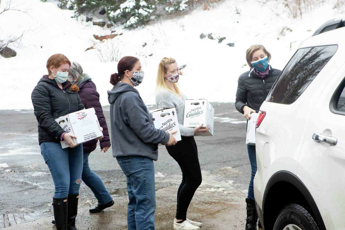 Litchfield County 4-H members deliver milk to local pantries.