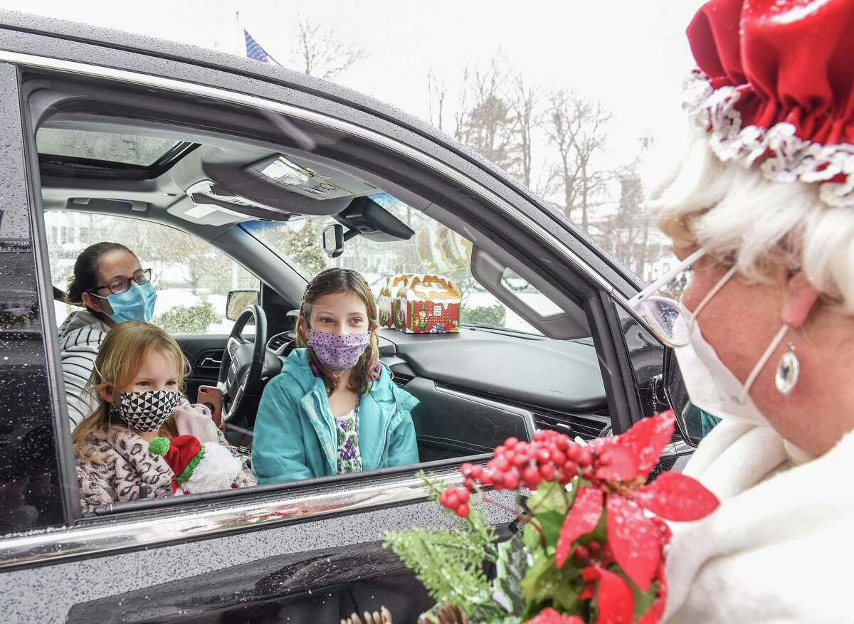 Mrs. Claus, portrayed by Christine O'Leary, greeted visitors at the Lounsbury House's 'Teddy Bear Tea' on Sunday, December 20, 2020, in Ridgefield, Connecticut.