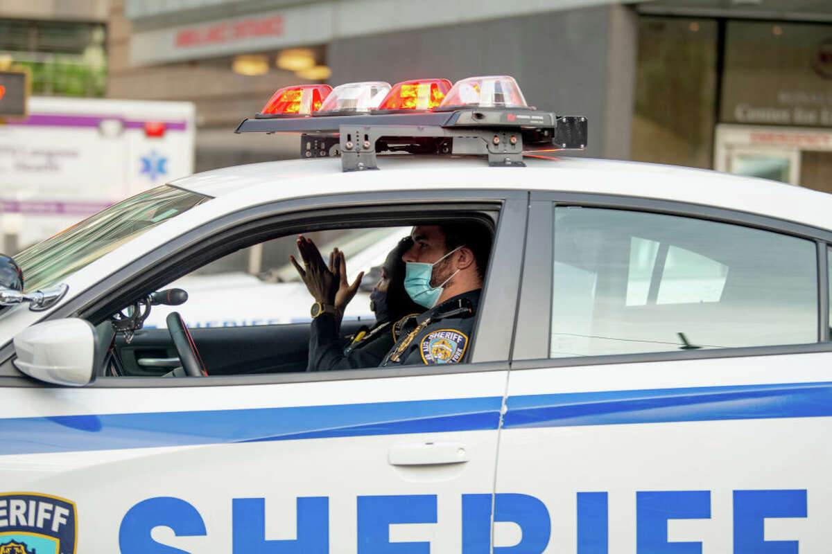 In New York City, the mayor is using sheriffs to enforce its traveler quarantine order.