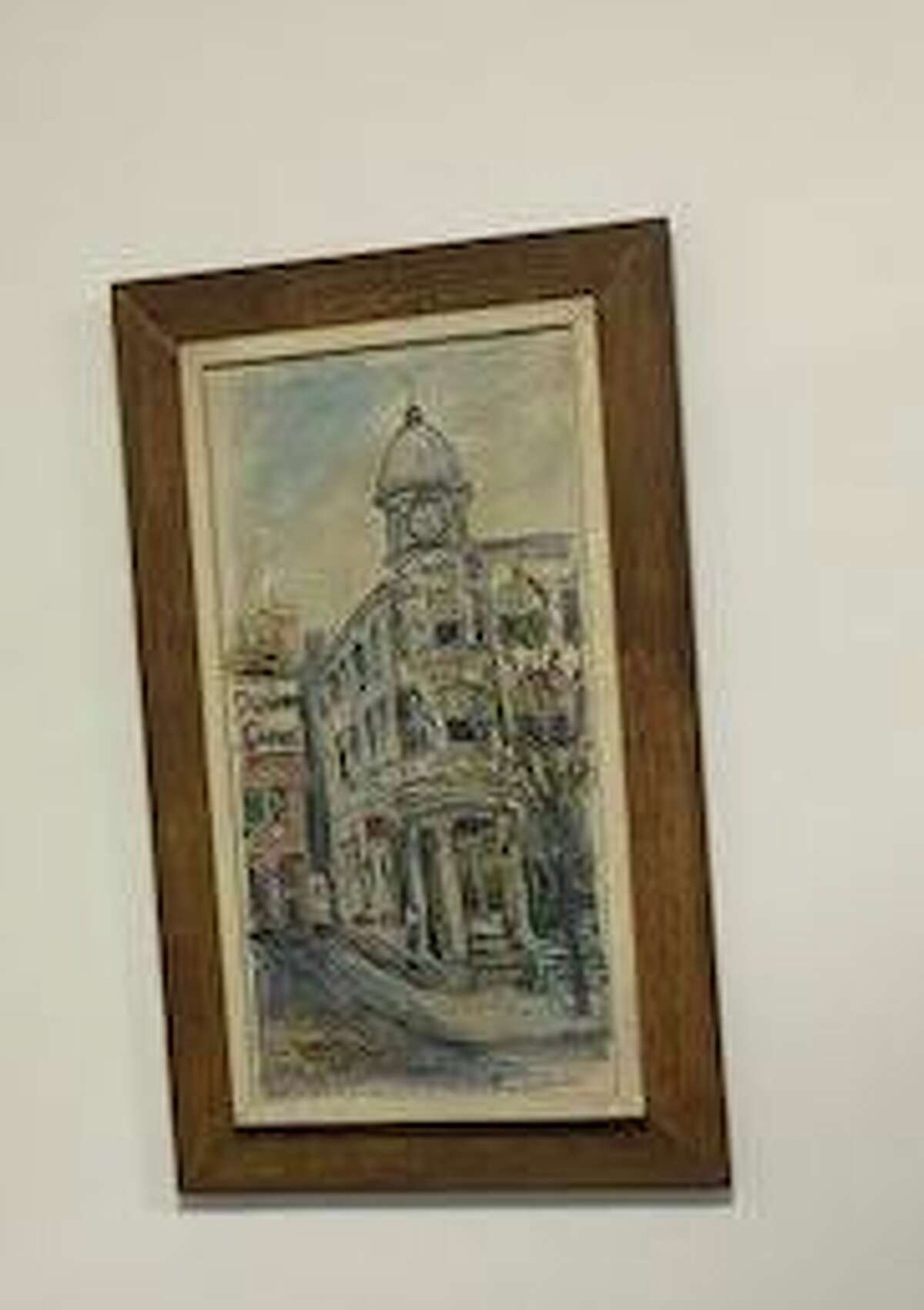 This painting in Editorial Page Editor Jacqueline Smith's office depicts the home of The News-Times on Danbury's Main Street before the newspaper operations expanded to a brick building at 333 Main St. Two years ago, offices moved to 345 Main St.