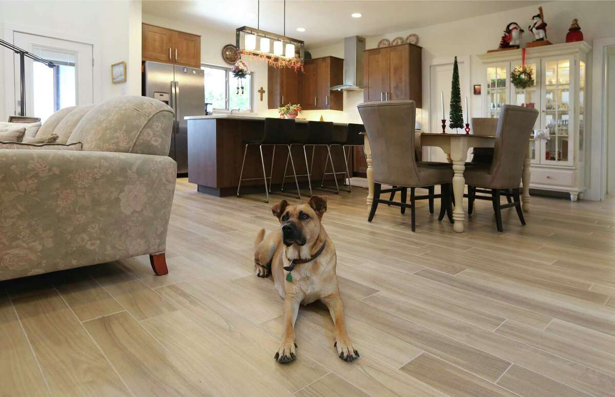 With two dogs Jack and Carol Banowsky are well aware that puppydog nails and wood floors do not play well together. So they installed a faux wood porcelain tile that, while not the real thing, doesn't scratch as easily either.