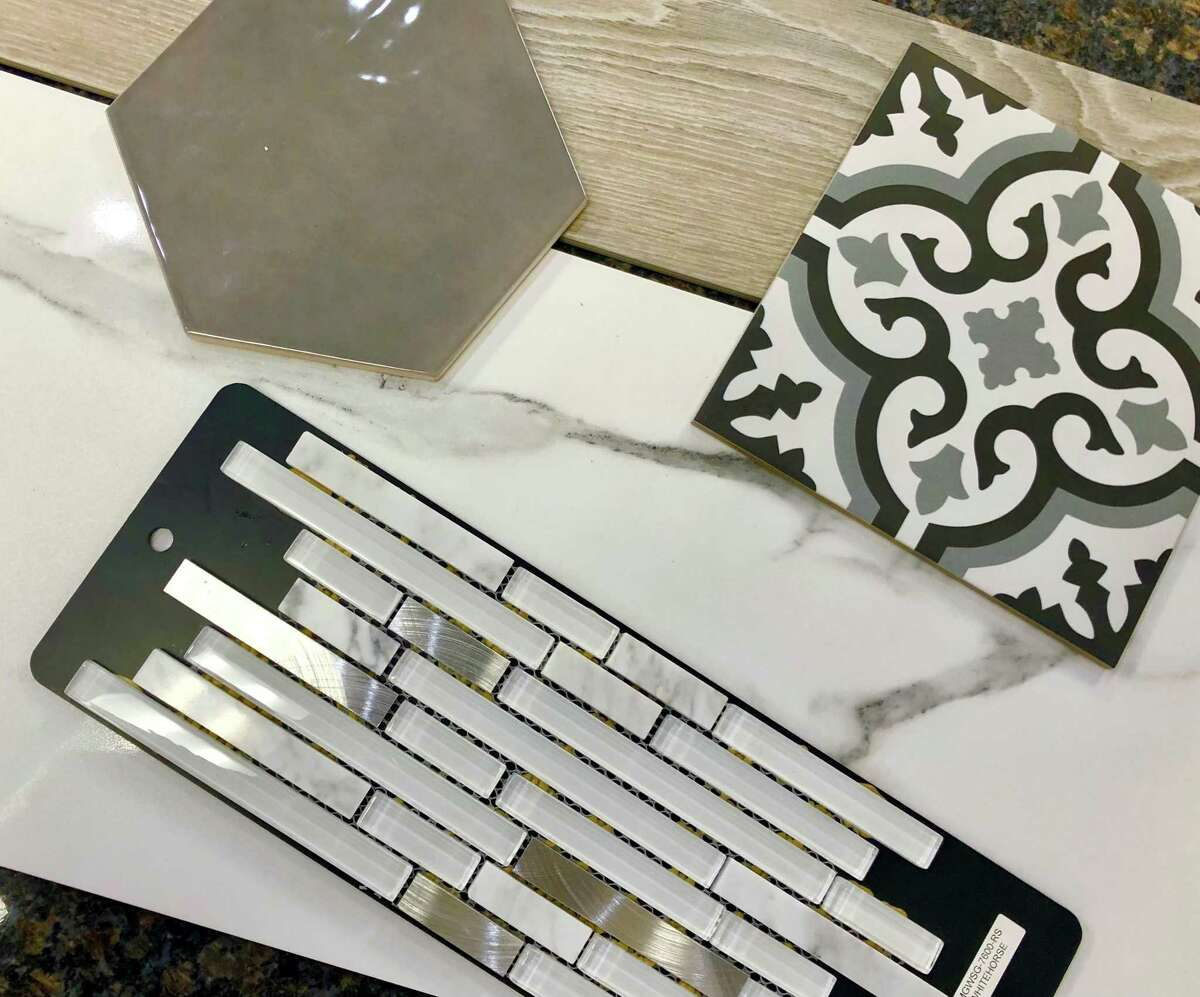 Tile trends for 2021 include, clockwise from top left, top layer, hexagon tiles, bolder encaustic tiles, mixed material mosaics. Also popular are tiles that mimic natural materials such as Carrara marble and wood, bottom layer.