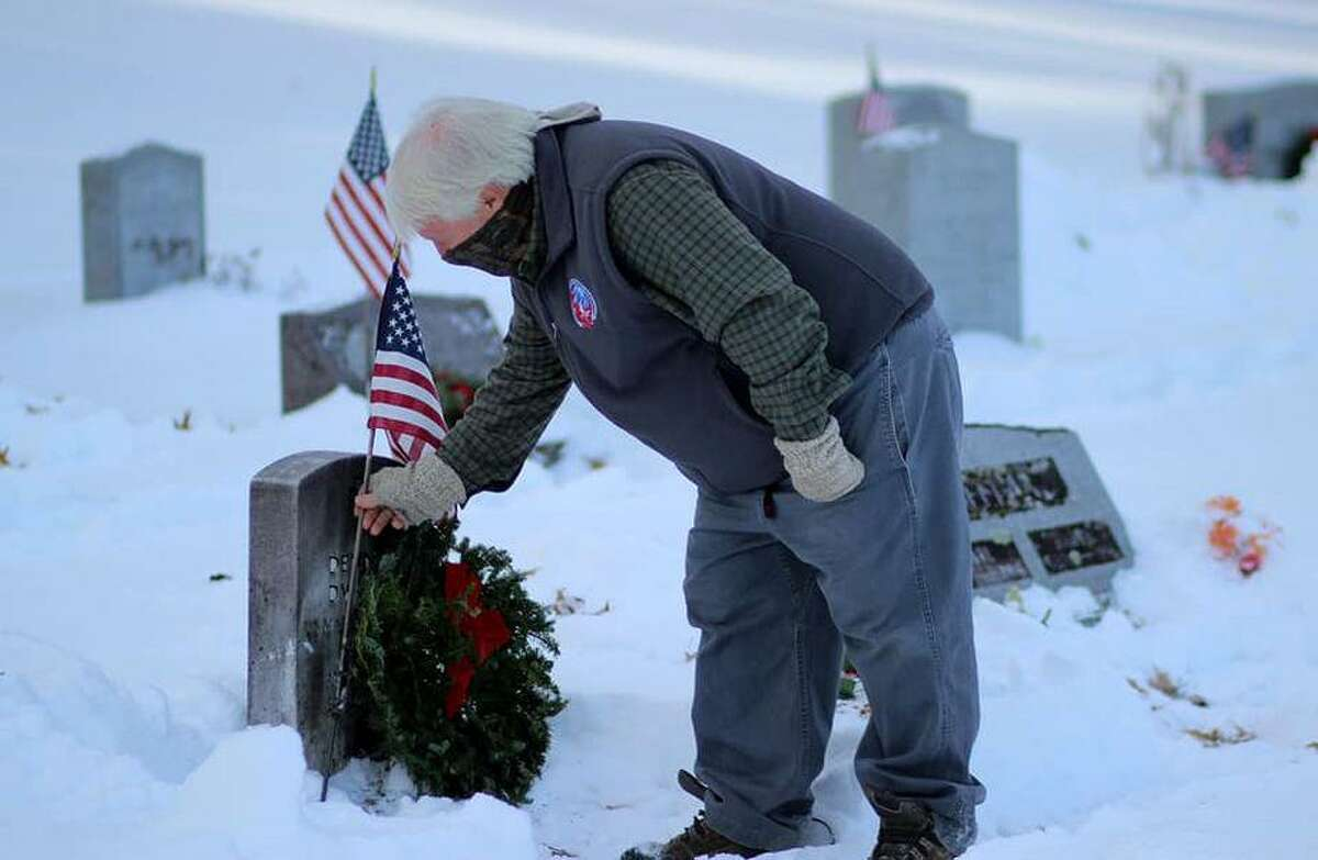Sen. Craig Miner paid tribute to fallen Veterans in observance of National Wreaths Across America Day at the Forest View Cemetery in Winsted on Dec. 19. The event was sponsored locally by the Daughters of the American Revolution Brooks Greenwood Chapter.