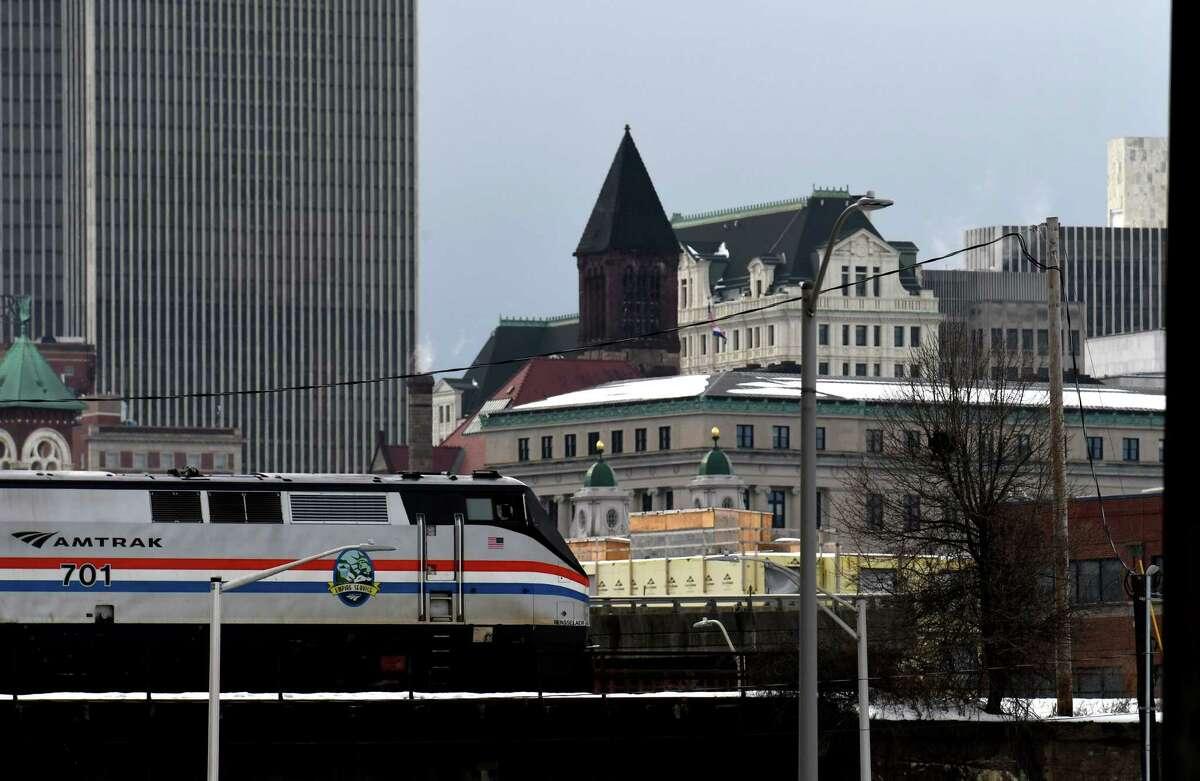 Am Amtrak train heads west through the city on Thursday, Dec. 24, 2020, in Albany, N.Y. (Will Waldron/Times Union)