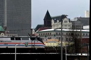 Am Amtrak train heads west through the city on Thursday, Dec. 24, 2020, in Albany, N.Y. (Will Waldron/Times Union)