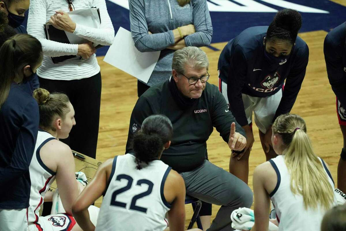 UConn Huskies coach Geno Auriemma talks to his players during a break in the action as they take on the Massachusetts Lowell River Hawks in the second half at Harry A. Gampel Pavilion in Storrs, Conn. on Dec. 12, 2020. UConn defeated Massachusetts Lowell 79-23.