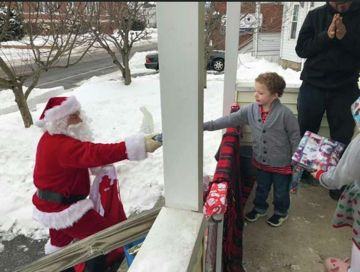 Santa hands out gifts to the youngest members of the Trujillo family, who were still in quarantine when he paid them a visit last week.