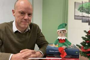 Stephen Robinson with the artificial intelligence elf he recently created. The elf is able to answer questions posed to it.