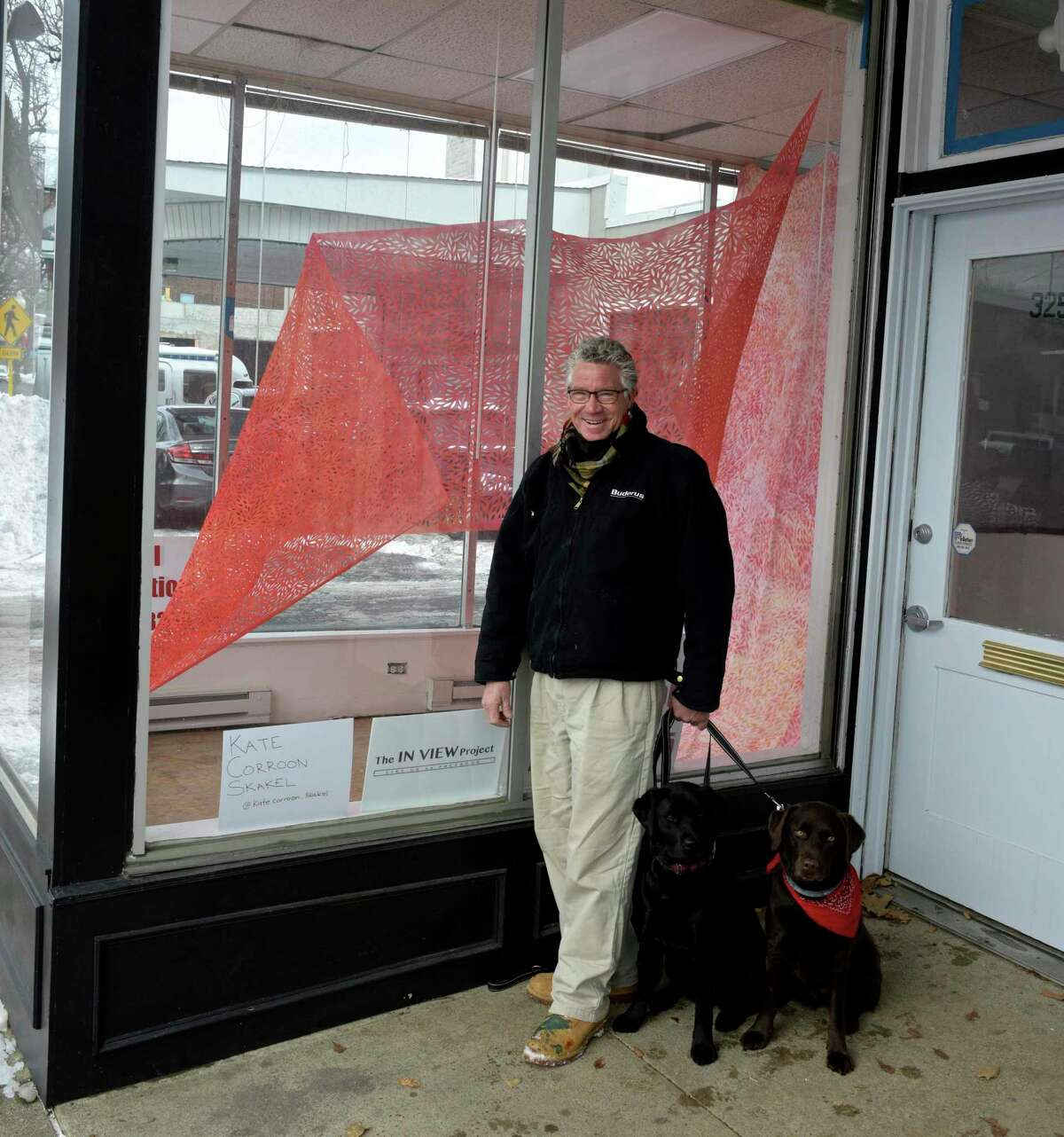 The In View project is taking vacant storefronts in downtown Danbury and turning them into mini art exhibits. Landlord Mark Nolan has done that with 325 Main Street, in Danbury, Conn, where artist Kate Corroon Skakel has work on display. Friday, December 18, 2020. With Nolan are Zelda, left, and Tula.