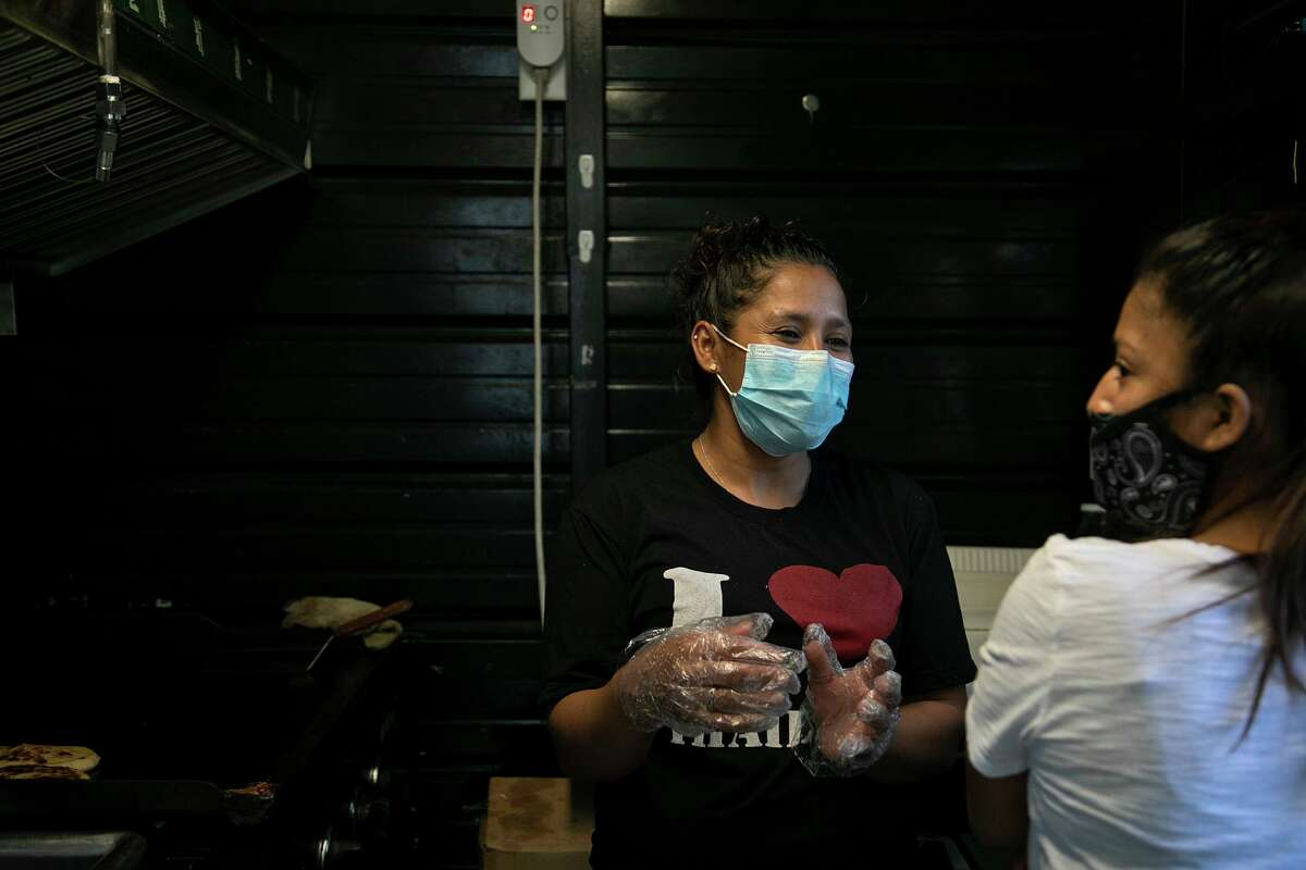 Santos Pacheco, left, and Rosa Vasquez make pupusas at Cafe Cotidiano in San Antonio. The women are originally from Honduras.