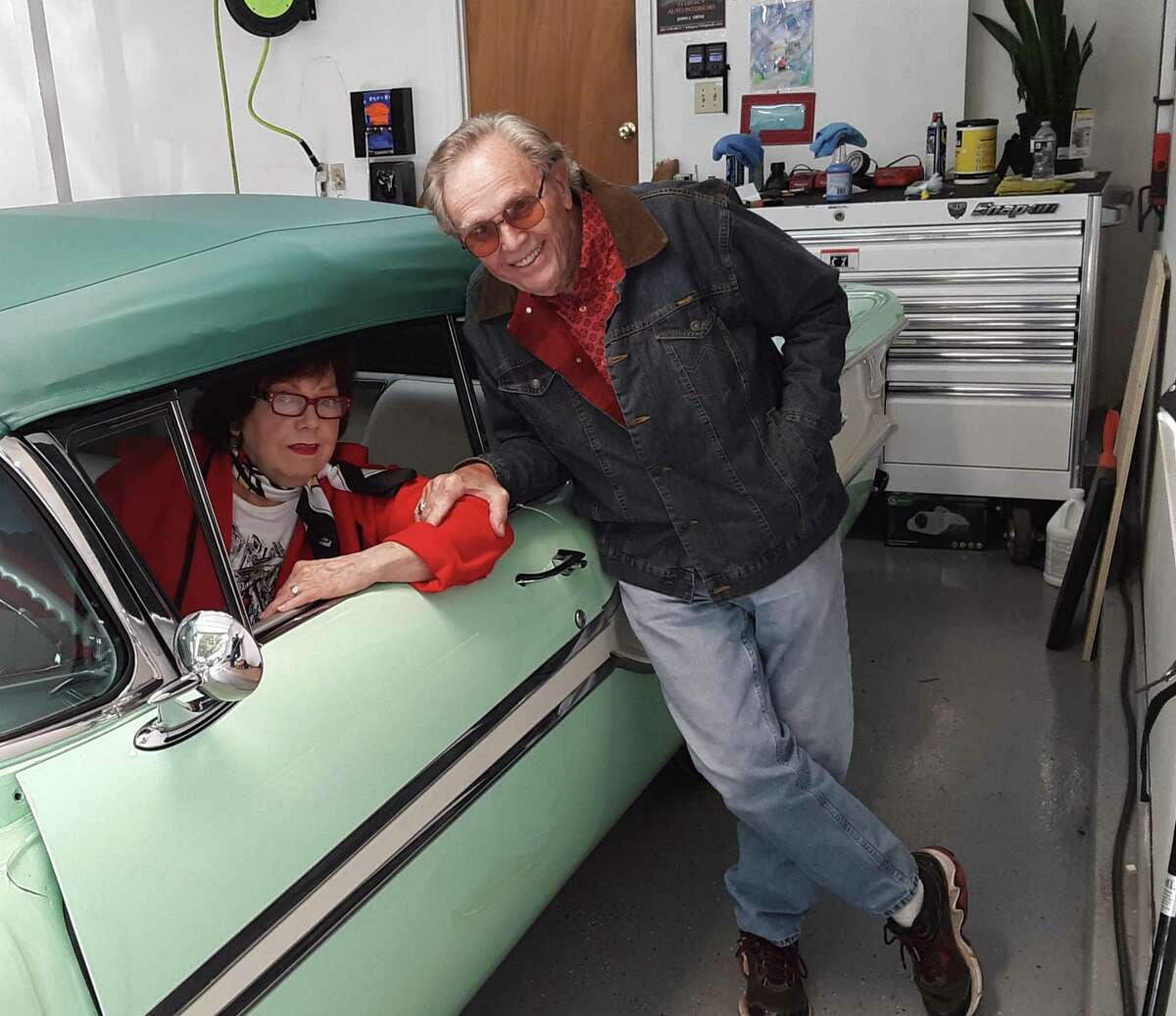C.D. Peterson and his wife, Odessa, in their nearly restored 1958 Pontiac Chieftain convertible.