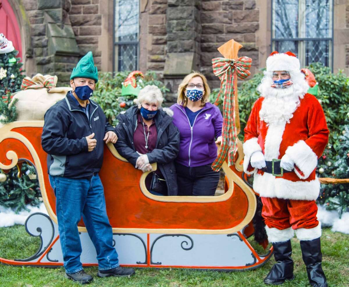 Middletown's Santa Claus of 33 years, retired fire marshal Al Santostefano, delighted those who participated in the recent Holiday on Main festivities downtown in COVID-19 friendly fashion. Artists at Kidcity Museum created a sleigh with Plexiglass separating children and families from Santa, who posed for photographs over 6 feet away on a red Vespa.