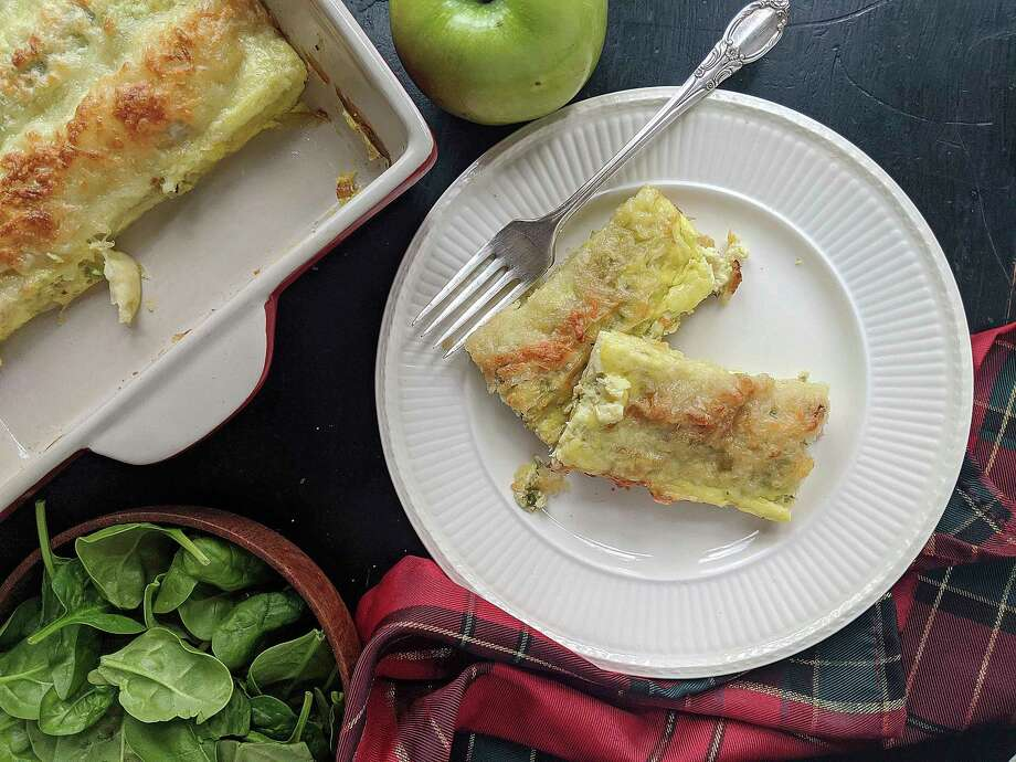 Crepe-like phyllo rolls are stuffed with a mixture of apples, shredded cheese, spinach, and ham, then topped with beaten eggs. (Gretchen McKay/TNS) / Pittsburgh Post-Gazette