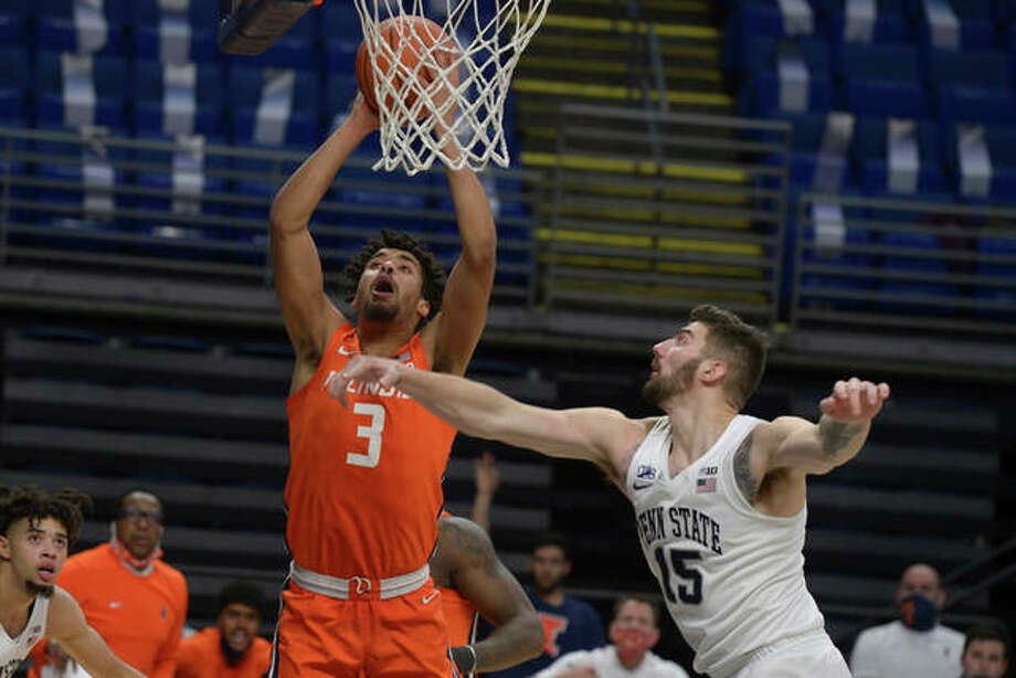 Illinois' Jacob Grandison (3) scores next to Penn State's Trent Buttrick (15) during the second half of an NCAA college basketball game Wednesday, Dec. 23, 2020, in State College, Pa.