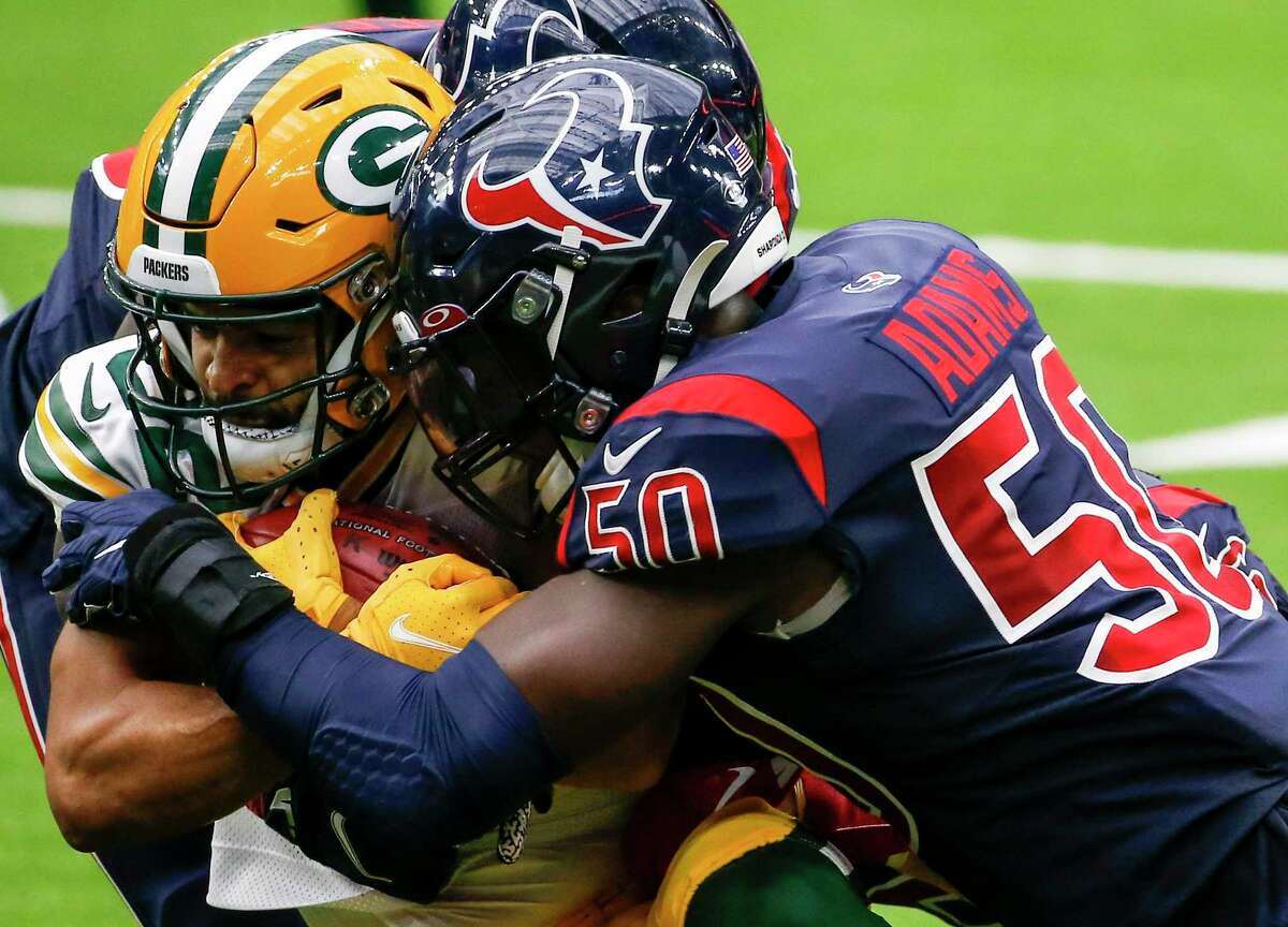 Texans linebacker Tyrell Adams introduces himself to Packers wide receiver Darrius Shepherd on a tackle at NRG Stadium in October 2020.