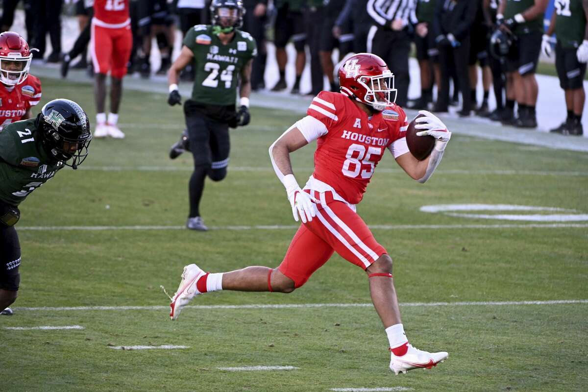 Houston tight end Christian Trahan (85) runs for a touchdown in the third quarter of the New Mexico Bowl NCAA college football game in Frisco, Texas, Thursday, Dec. 24, 2020. (AP Photo/Matt Strasen)