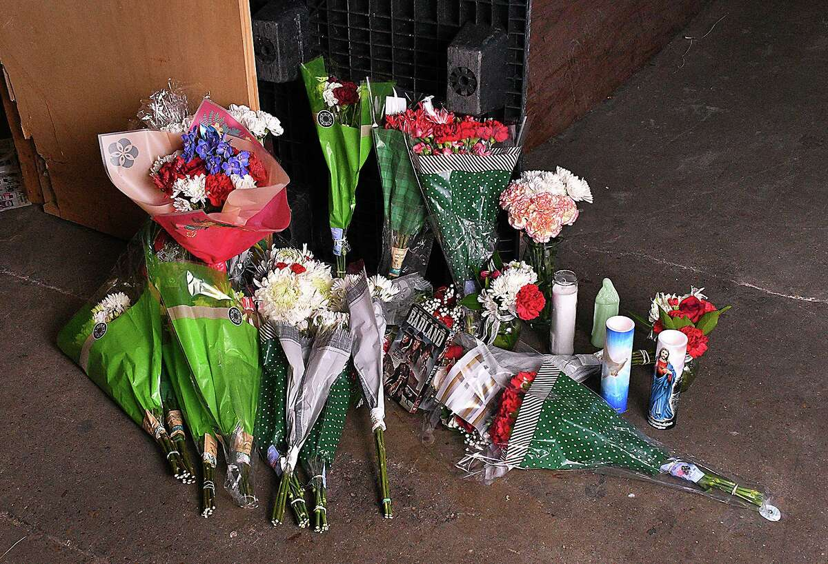 Floral bouquets, LED candles, a basket filled with Christmas treats and a DVD of one of his favorite movies mark the scene where longtime LMT employee Jose Homero Gonzalez Jr. lost his life.