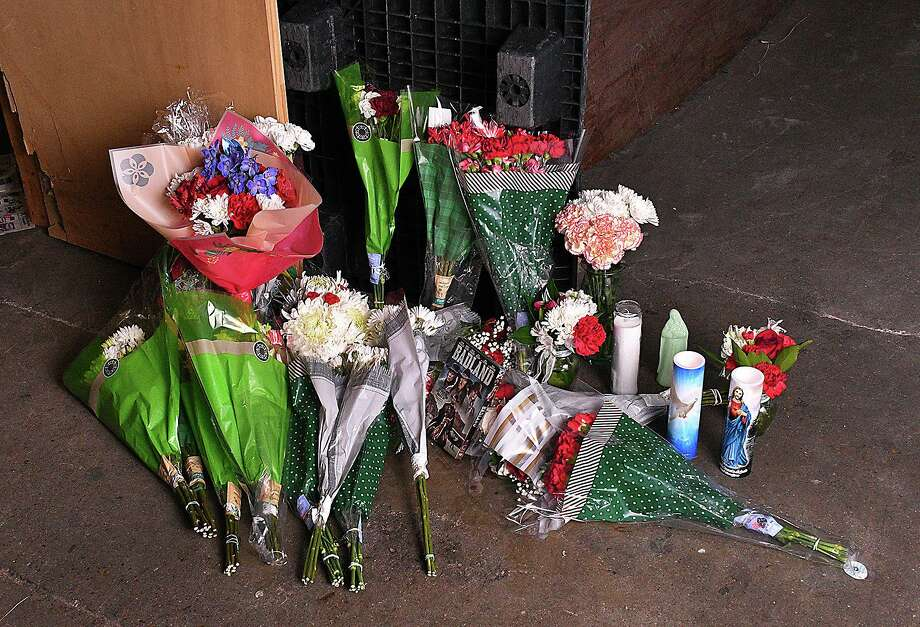 Floral bouquets, LED candles, a basket filled with Christmas treats and a DVD of one of his favorite movies mark the scene where longtime LMT employee Jose Homero Gonzalez Jr. lost his life. Photo: Cuate Santos /Laredo Morning Times