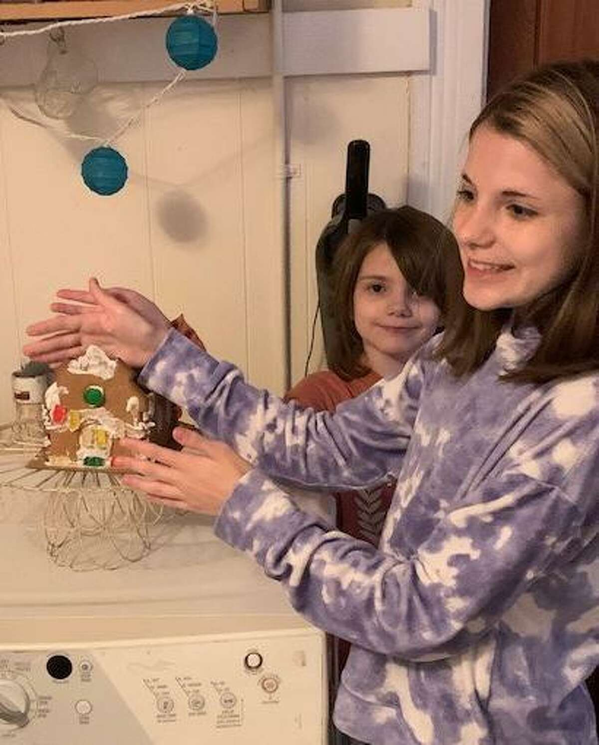 The Warner Theatre recently announced the winners of its gingerbread house contest. Above, runner-ups Maizey and Mallory T. explain their house.