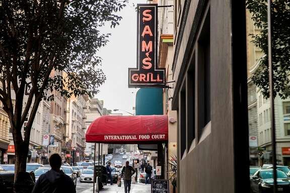 The sign for Sam's Grill and Tavern is seen illuminated on the street in the Financial District of San Francisco, Calif. Thursday, Jan. 10, 2019.