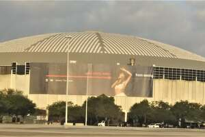 This Selena wrap promoting the Netflix series is on the Houston Astrodome and features Christian Serratos.