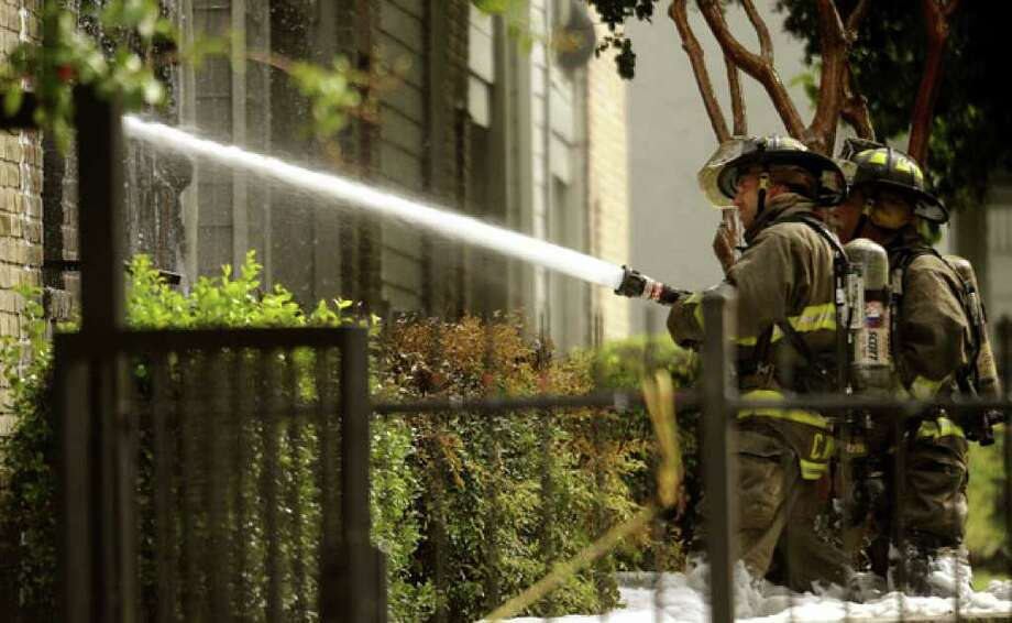 Firefighters battle the blaze at the Churchill Park Apartment Homes in the 1200 block of Patricia Drive.