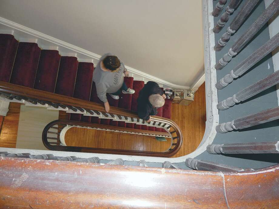 The path of the three-story staircase creates a geometric design as visitors to the Ayers Mansion walk down the stairs. Photo: Angela Bauer | Journal-Courier