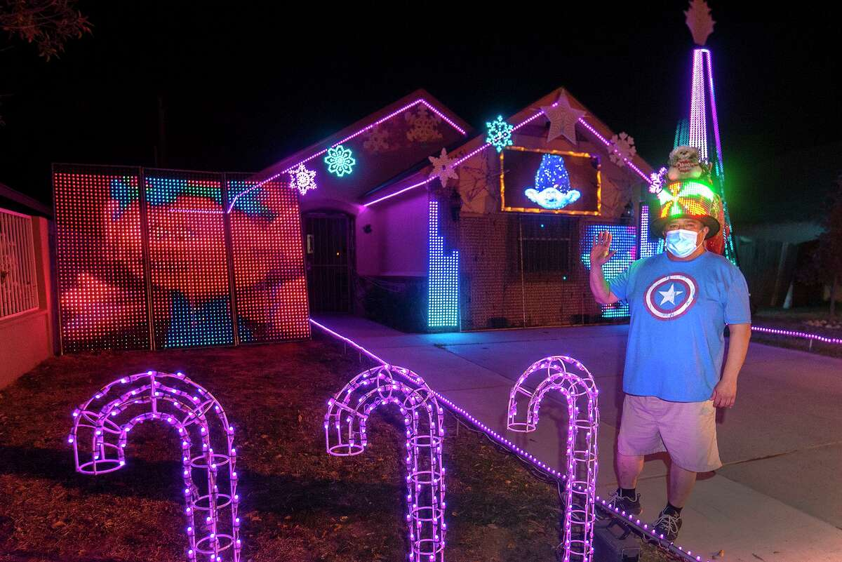 Tomas Rodriguez is pictured in front of his Christmas light show on Tuesday, Dec. 23 outside his home located at 1431 Wilfrano Dr.