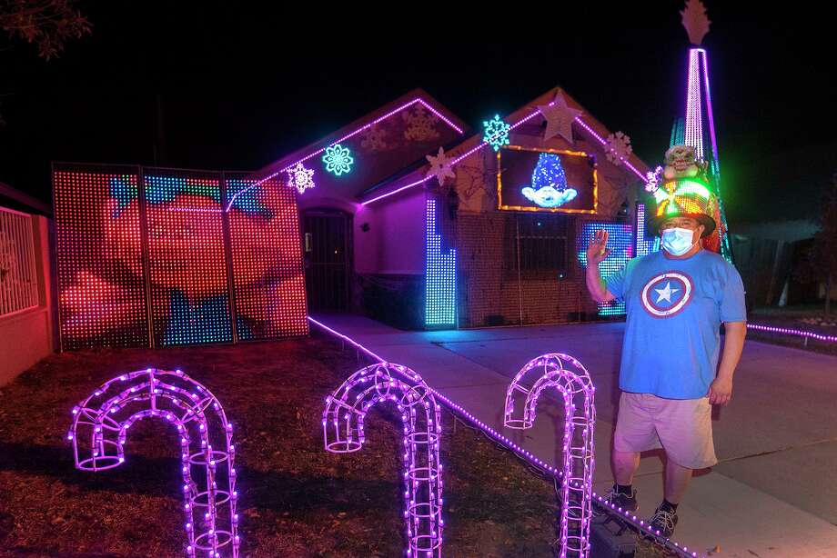Tomas Rodriguez is pictured in front of his Christmas light show on Tuesday, Dec. 23 outside his home located at 1431 Wilfrano Dr. Photo: Danny Zaragoza / Laredo Morning Times