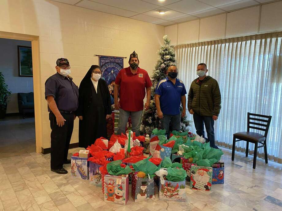 The Veterans of Foreign Wars Post 9194 and American Legion Post 59 came together on Christmas Eve to donate gift bags to the children at the Sacred Heart Children's Home. Photo: Courtesy
