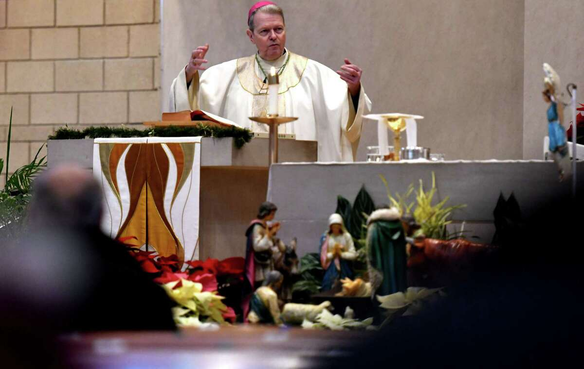 Bishop Edward Scharfenberger delivers his Christmas Day sermon at St. Madeleine Sophie Church on Friday morning, Dec. 25, 2020, Guilderland, N.Y. Bishop Scharfenberger spoke of the history and symbology of the Christmas Nativity scene. (Will Waldron/Times Union)