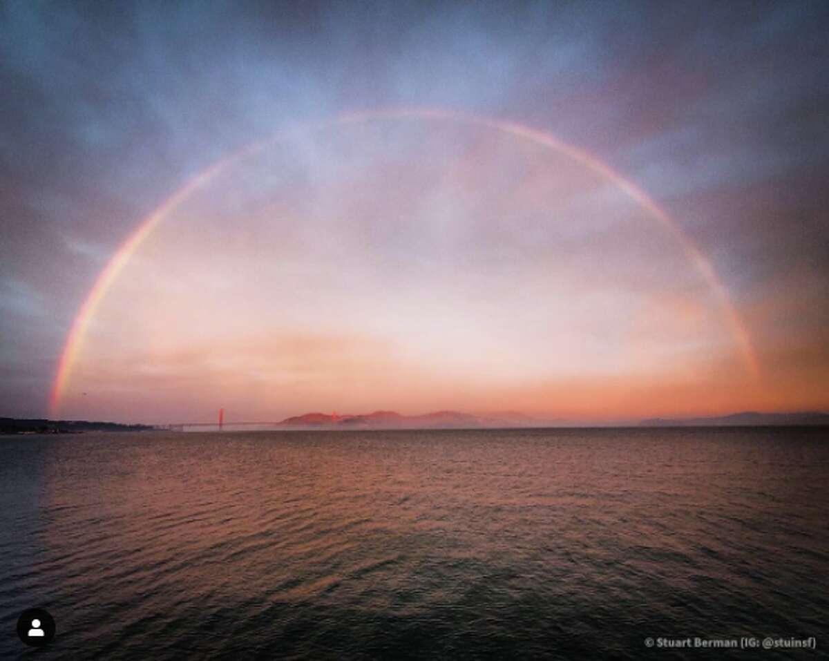 A beautiful rainbow is seen over the water on Christmas Day.