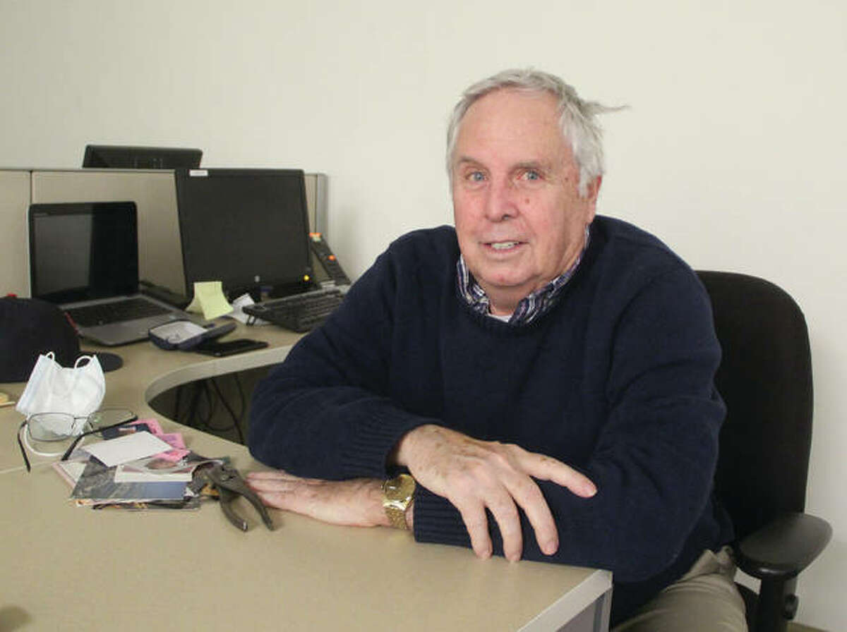 Long-time Telegraph reporter and editor Sanford Schmidt takes a break while cleaning out his desk. Schmidt retired Wednesday after 47 years of covering news for The Telegraph.