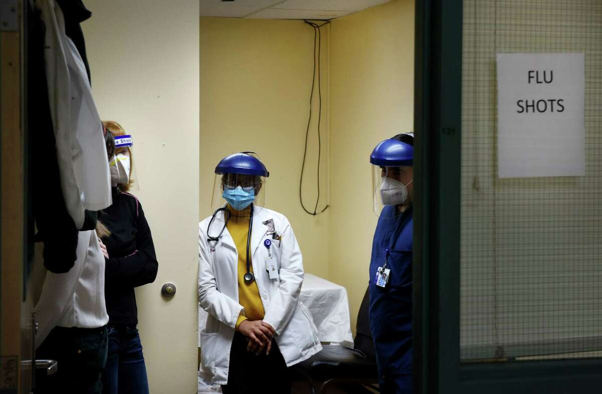 Students from Albany Medical College were on hand to deliver flu shots at the Capital City Rescue Mission under the supervision of Dr. Bob Paeglow on Friday, Dec. 25, 2020, in Albany, N.Y. (Will Waldron/Times Union)