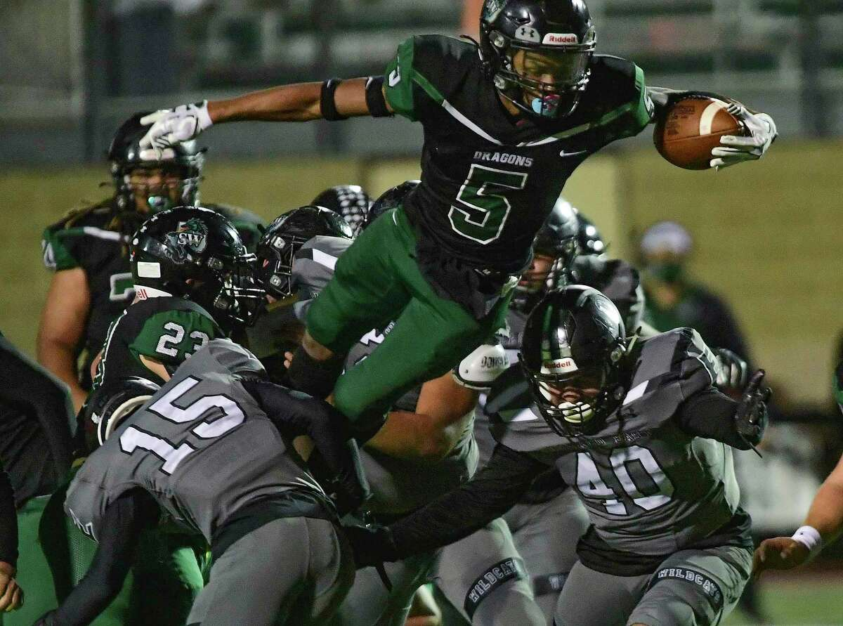 Southwest running back Andre Mitchell vaults for yardage in last week's playoff victory against Weslaco East on Dec. 18 at Dub Farris Stadium. Mitchell rushed for a team-high 135 yards and a touchdown, and he also had one catch for 31 yards.