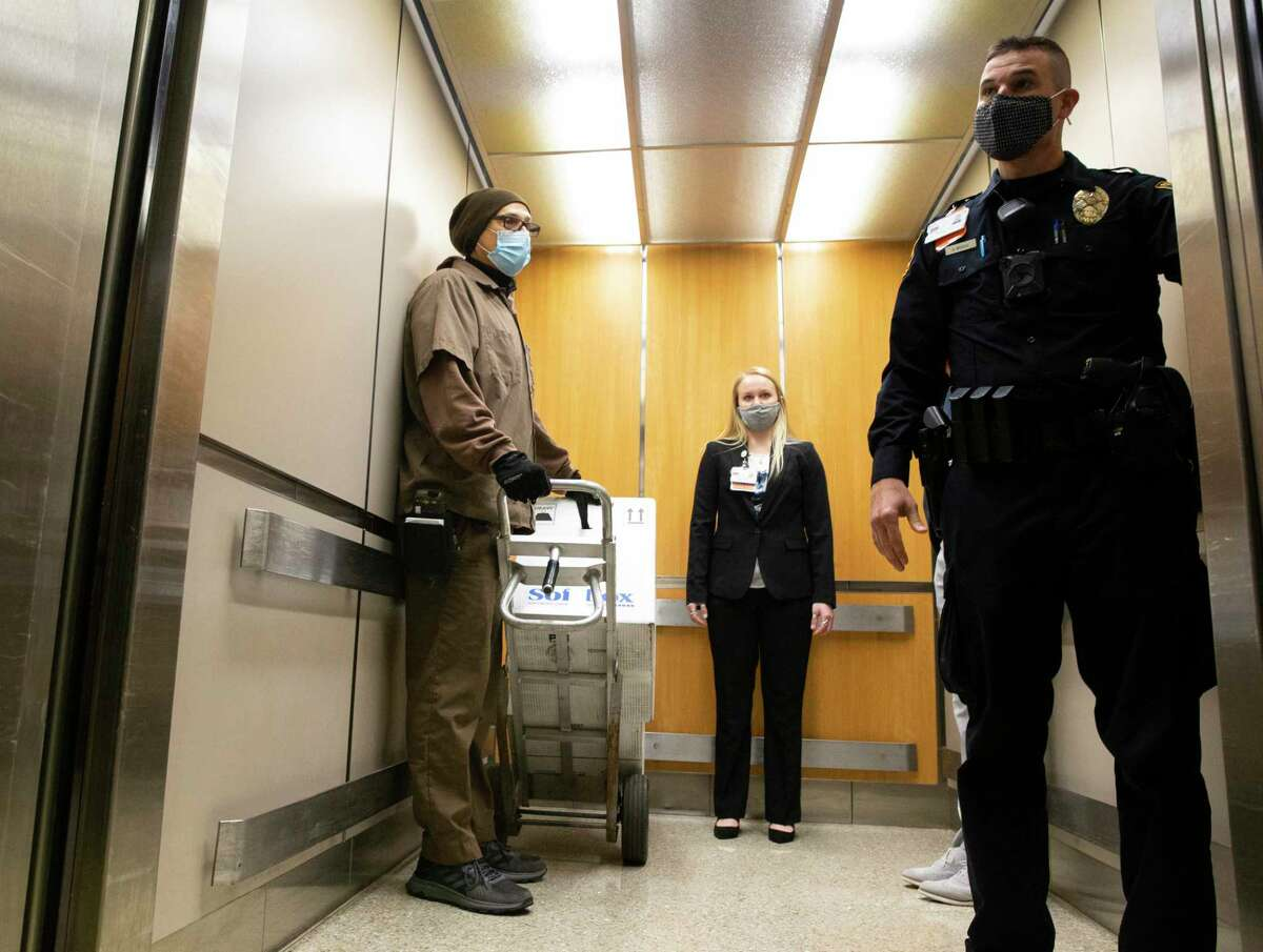 A UPS driver delivers 2,900 doses of COVID-19 vaccine to the UTMB Galveston campus on Dec. 15.