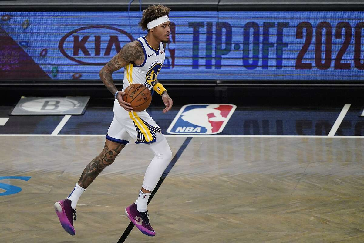Golden State Warriors forward Kelly Oubre Jr. (12) takes the ball down court during the first quarter of an opening night NBA basketball game, Tuesday, Dec. 22, 2020, in New York.