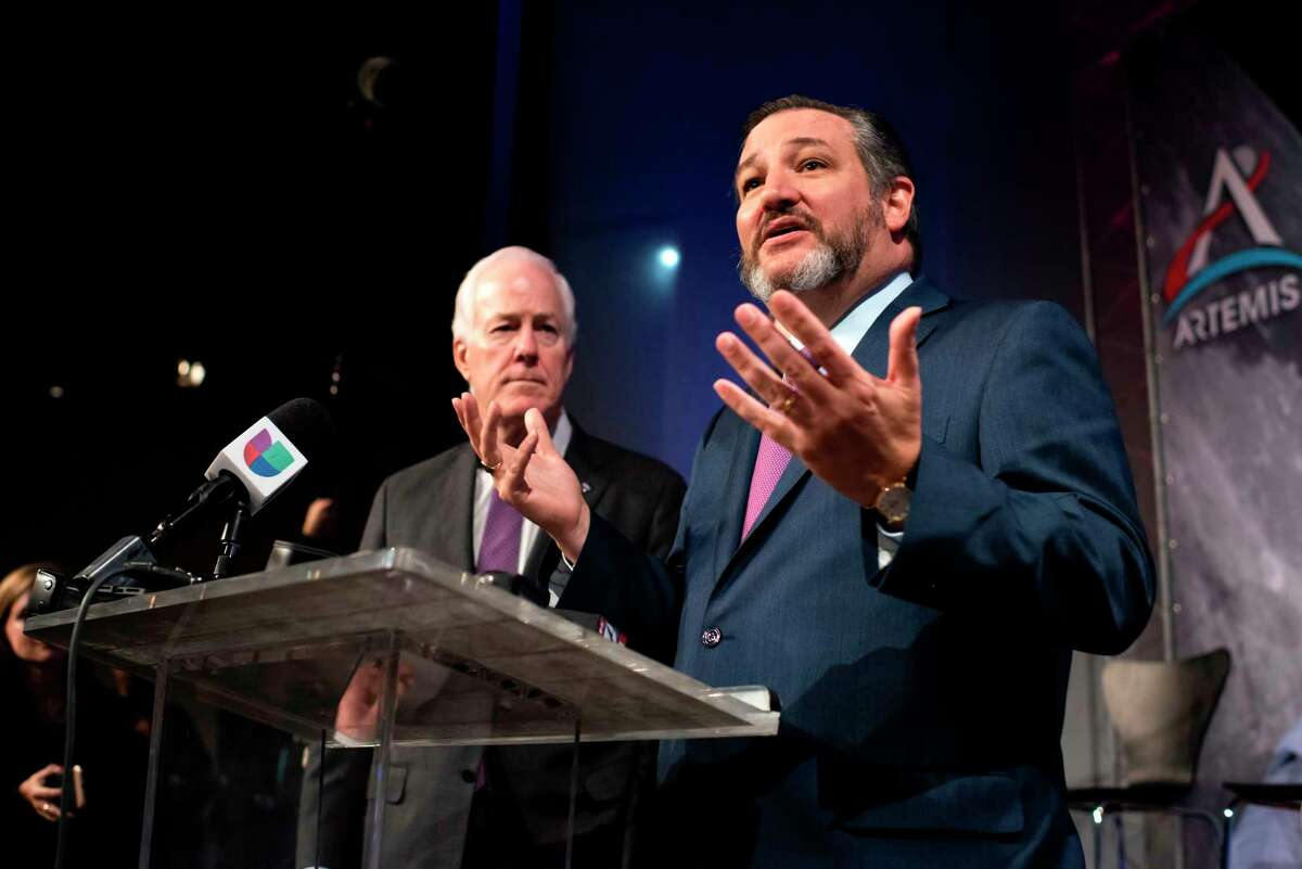 US Senators Ted Cruz, right, and John Cornyn take part in the astronaut graduation ceremony at Johnson Space Center in Houston Texas, on Jan. 10, 2020. (Mark Felix/AFP/Getty Images/TNS)