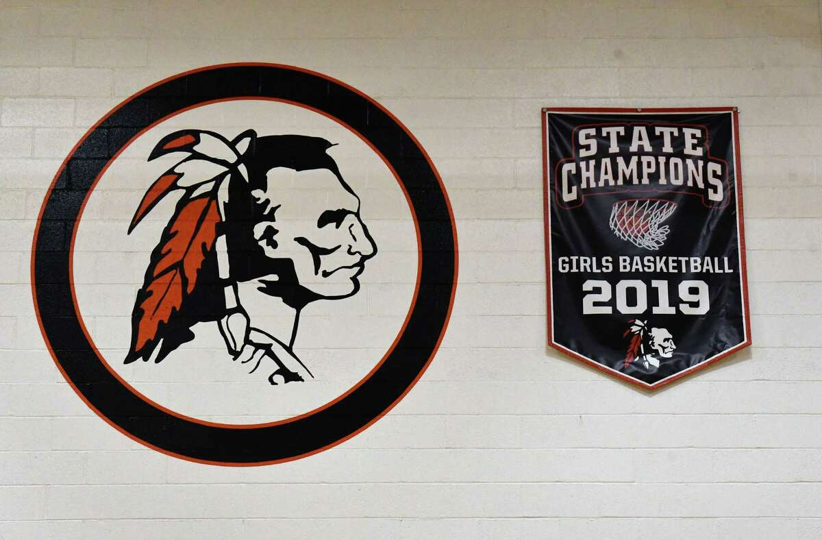 """A championship banner is seen a wall in the gymnasium at Cambridge High School is one of many places where the """"Indians"""" mascot is displayed.(Lori Van Buren/Times Union)"""