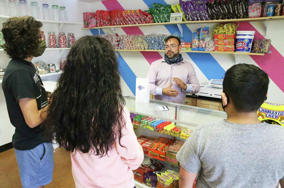 Todd Arnold serves customers at the Candy Store mid day on Dec. 22, 2020.