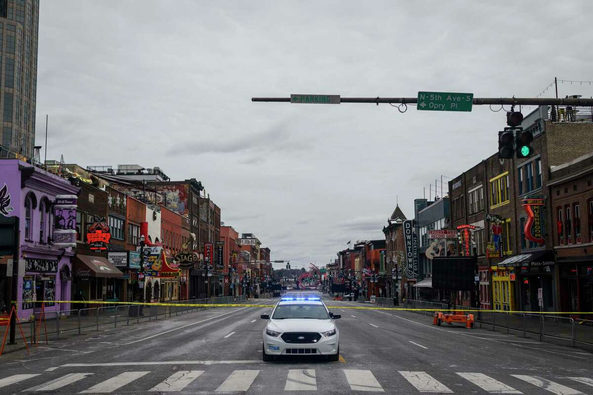 Police block off Nashville, Tenn.'s Broadway while investigating an explosion Friday, Dec. 25, 2020.