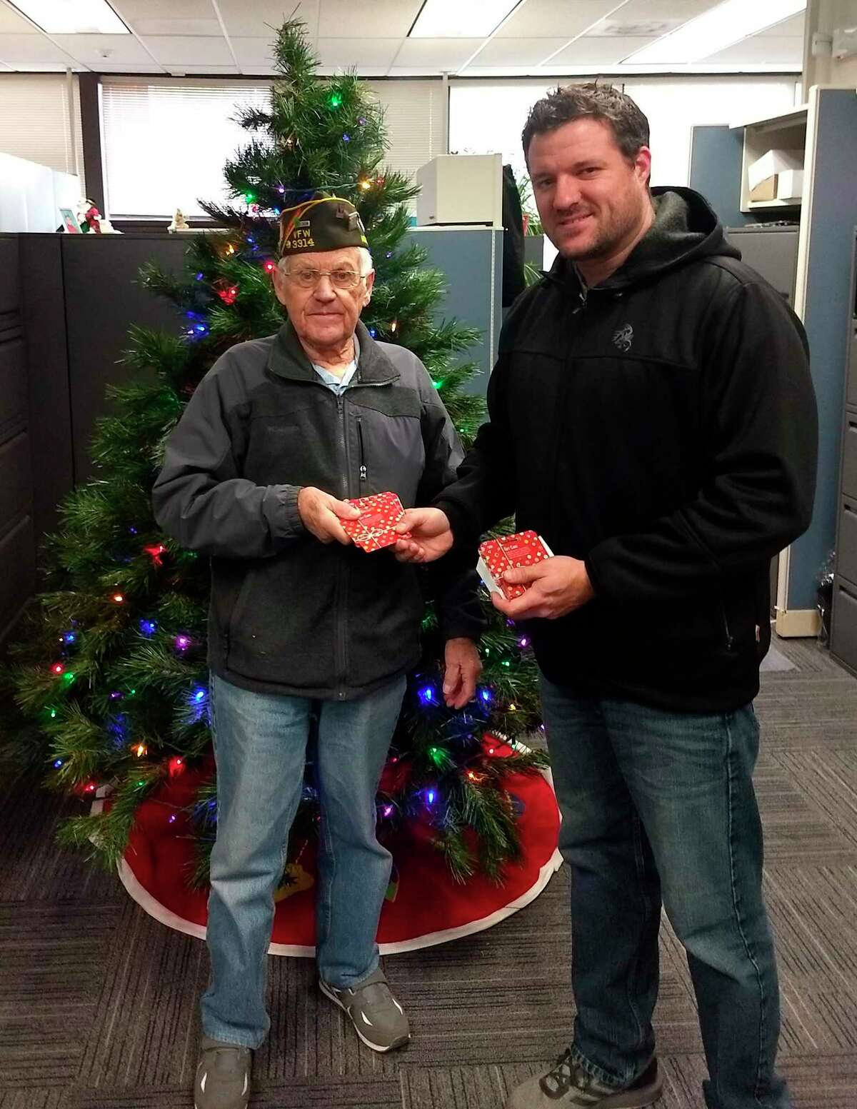 In this 2019 photo, Arcadia VFW Post 3314 Quartermaster Keith McArthur (left) presents a donation to Matthew Dotson, Community Resource Coordinator at Benzie-Manistee MDHHS. (Courtesy photo)