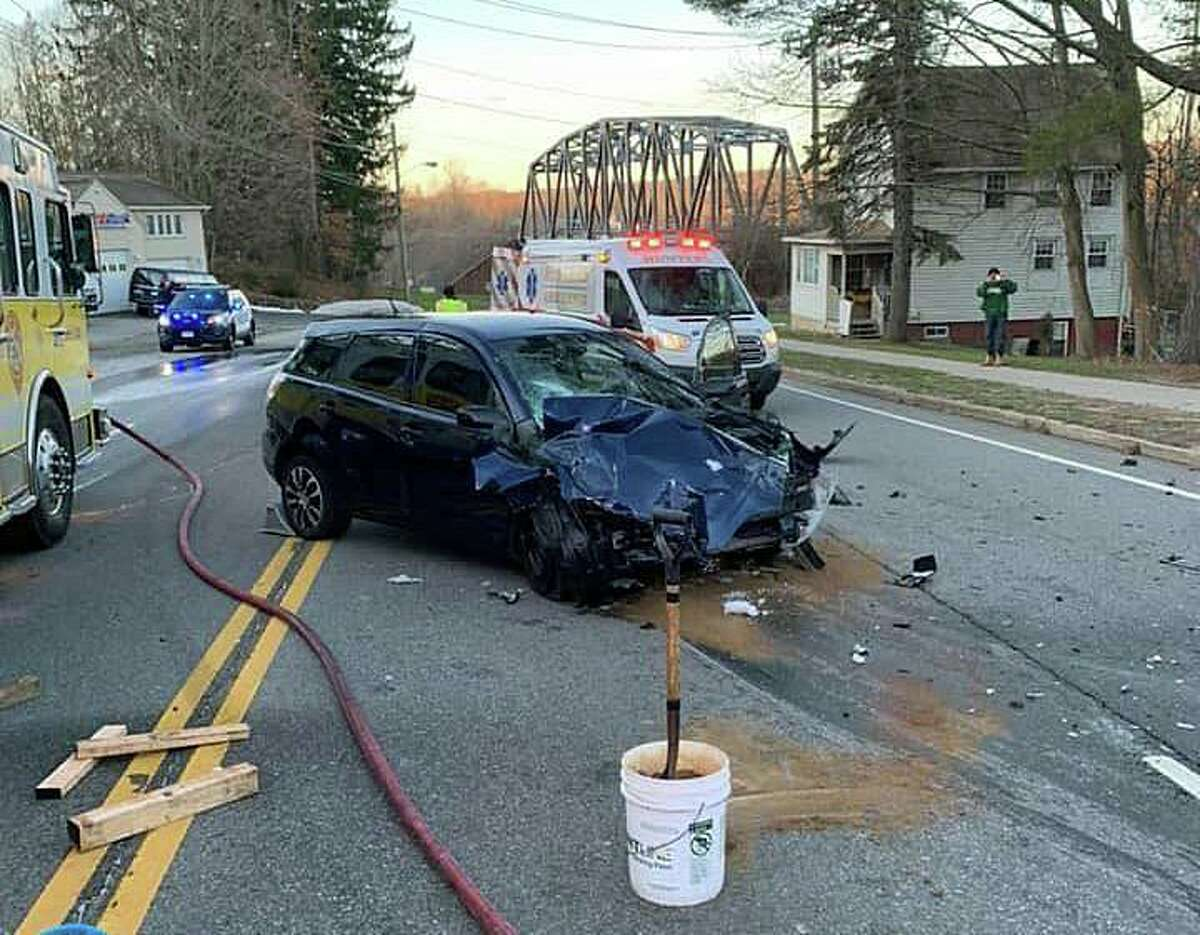 A two-vehicle crash closed part of Route 66 on Saturday morning on Dec. 26, 2020, officials said. The force of impact from the collision caused one of the vehicles to rollover to a nearby house. One person, who was trapped in a vehicle, was extricated by firefighters and taken to the hospital.