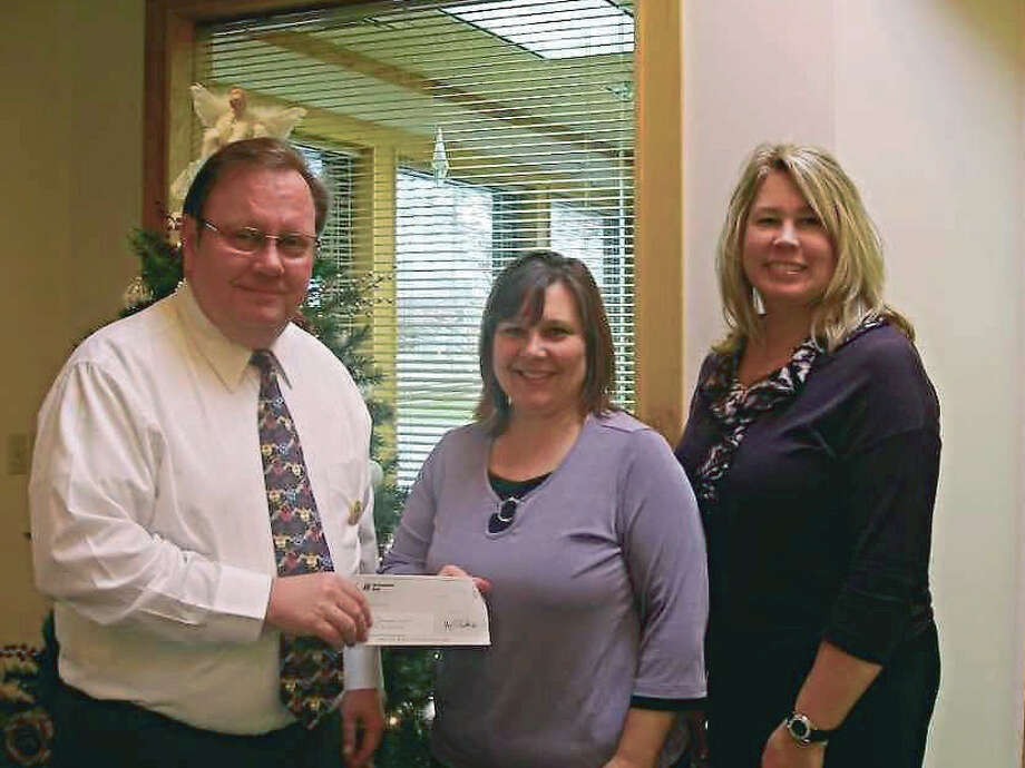 In January 2012, Northwestern Bank contributed $500 to support the Family Life Center program of Love INC Manistee (now ECHO His Love). Pictured (from left to right) are Steve Brower, of Northwestern Bank; Robin Paulus, of Love INC; and Mary Kay Wilkosz, of Northwestern Bank. The donation was made in honor of the Northwestern customers. Photo: Courtesy Photo
