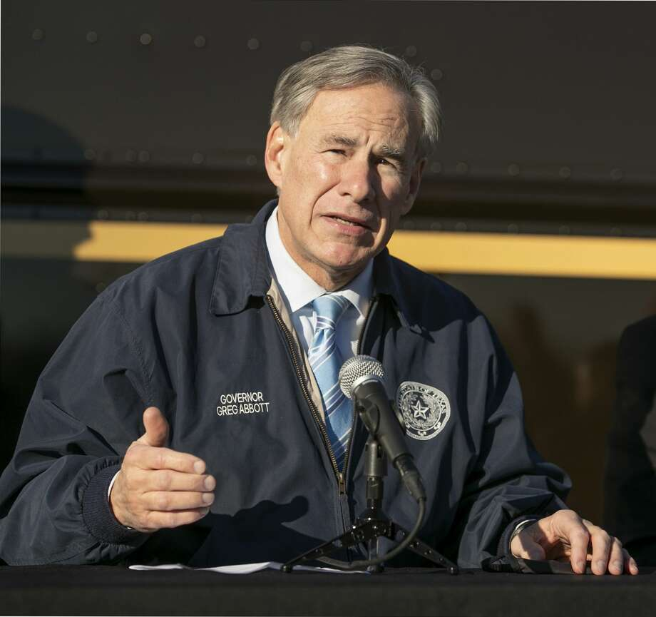 Gov. Greg Abbott talks about the Pfizer-BioNTech COVID-19 vaccine on Dec. 17. Abbott has pardoned a woman convicted of assault in Midland County. Photo: Jay Janner/Associated Press / Austin American-Statesman