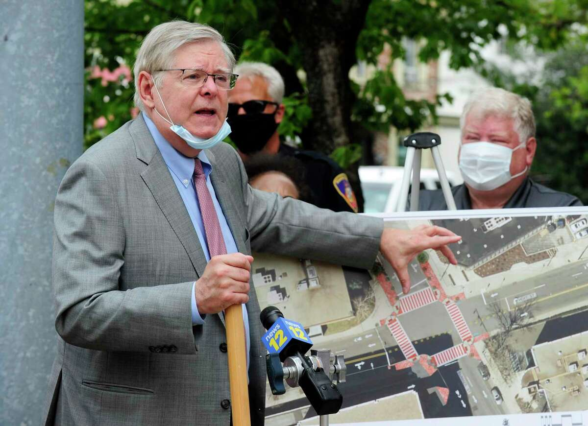 Stamford Mayor David Martin points to an photo overview as he and Jim Travers. Bureau Chief for the City of Stamford Transportation, Traffic and Parking, announce $1.4 million pedestrian safety project along Summer Street in downtown Stamford, Connecticut on July 23, 2020. The improvements at the Summer Street intersections at Main Street, Broad Street, North Street and Hoyt Street, sites of several accidents involving pedestrians including a fatal, will take until the end of the year to complete. A bump out the curb line to give more room to pedestrians on those 12 corners, while installing high visibility thermo plastic crosswalk treatment and lighted signs will also be put in place to let drivers know when to yield to pedestrians.