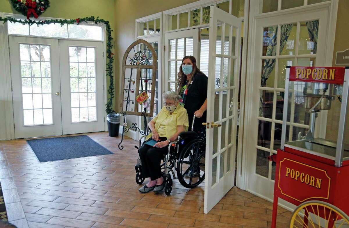 Freddye Riggs, 94, is assisted by from Kristy Graphman, executive director of Elmcroft of Windcrest.